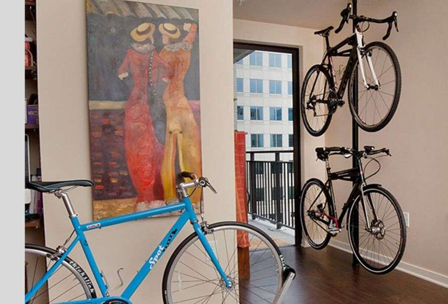 Non-permanent ceiling to floor clamp bike rack